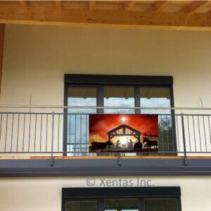 alt=balcony-banner-nativity-silhouette