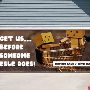 alt=garage-door-banner-moving-sale-boxes